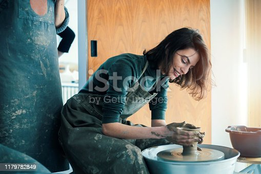 Young woman artist in ceramic workshop