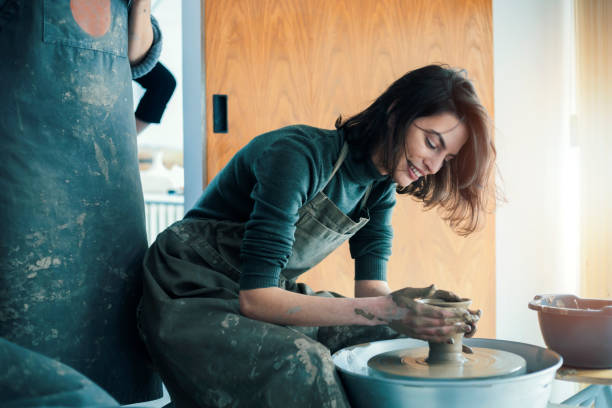 Ceramic workshop Young woman artist in ceramic workshop hobbies stock pictures, royalty-free photos & images