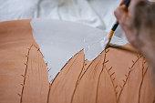 Mid adult woman creating handmade ceramics
