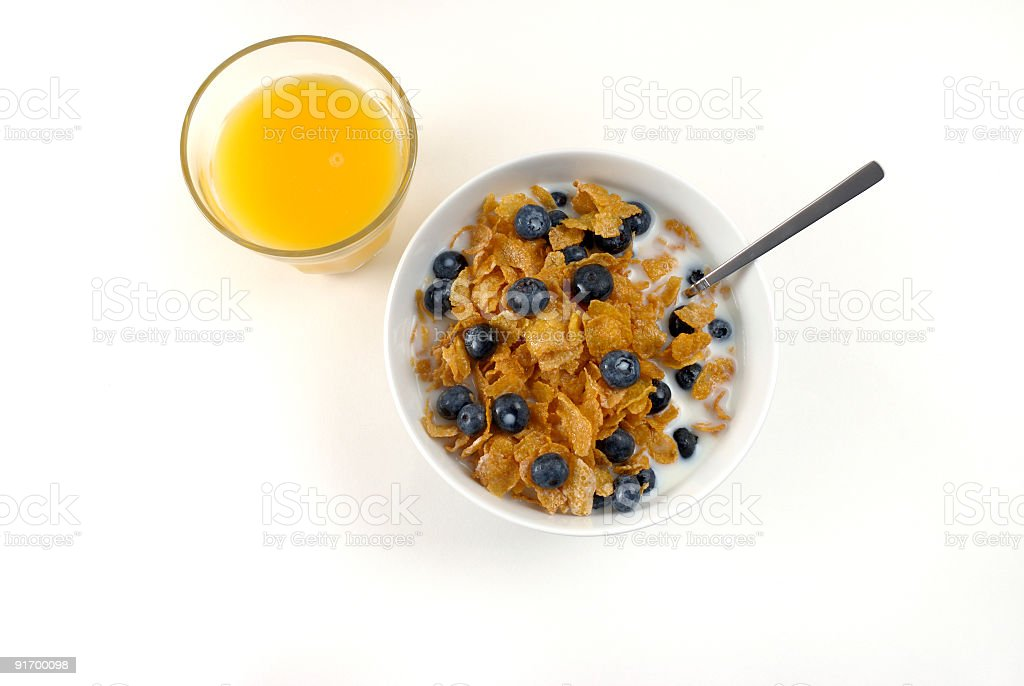 Cereal and a glass of orange juice royalty-free stock photo