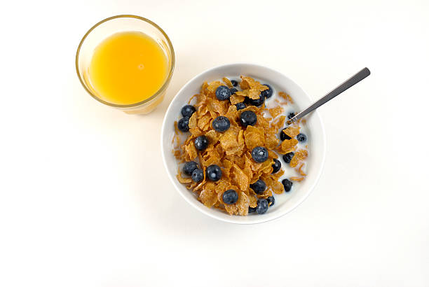 Cereal and a glass of orange juice stock photo