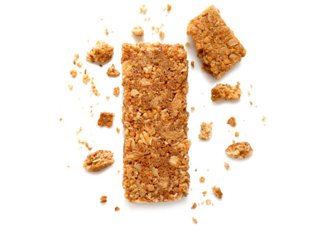 cereal bars or flapjacks made from rolled oats - briciola foto e immagini stock