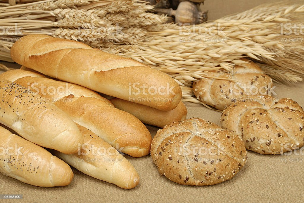 Cereal roll, baguette and corn on the table royalty-free stock photo