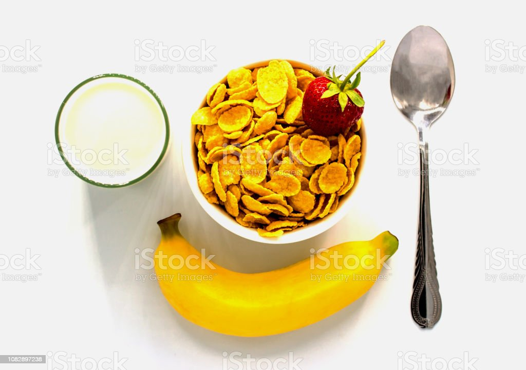 Cereal with milk and banana and strawberry on white background stock photo