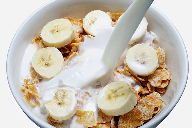 Cereal with slices of banana & milk stock photo
