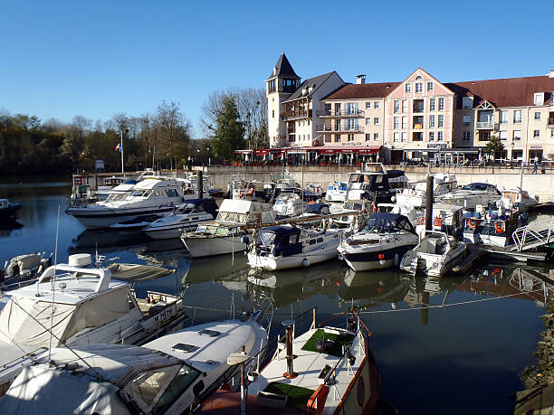 Cergy port Cergy, France on December 2, 2012: Port Cergy is a marina on the River Oise. The site comprises both housing and recreational yachtsl. The northern part of the site is reserved for restaurants and shops and have been built around a small bassin. val d'oise stock pictures, royalty-free photos & images