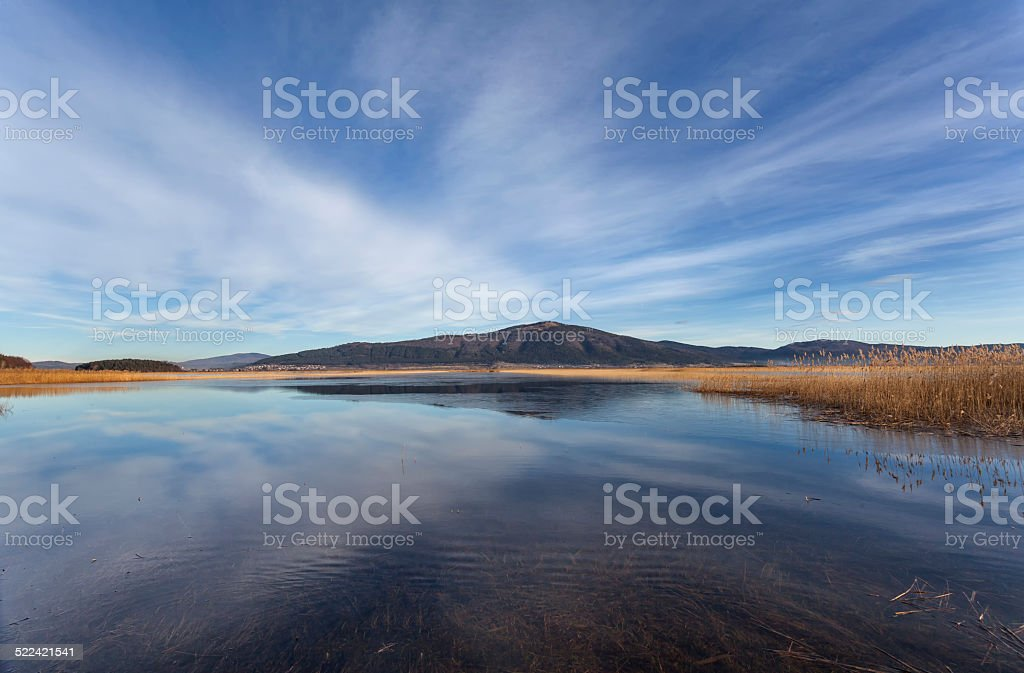 Cerknica lake with mountain Slivnica, Slovenia stock photo