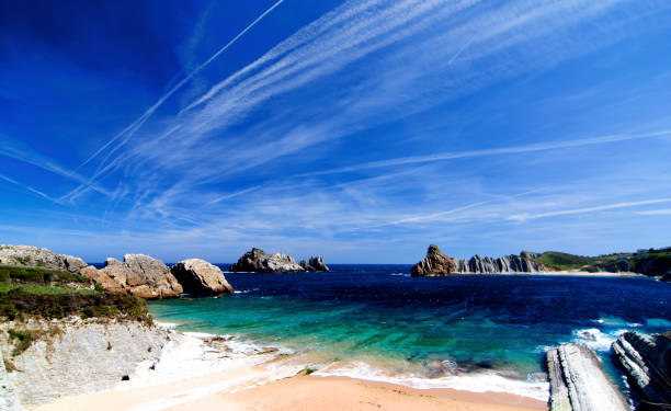 Cerrias Beach, Cantabria, Spain View on Playa De Cerrias in Sunny Day Outdoors. Seascape on the North Coast of Spain, Cantabria santander spain stock pictures, royalty-free photos & images