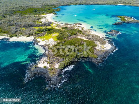 Aerial view of the sandy Cerro Brujo Beach at the north western coast of San Cristobal Island, Galapagos, Ecuador.