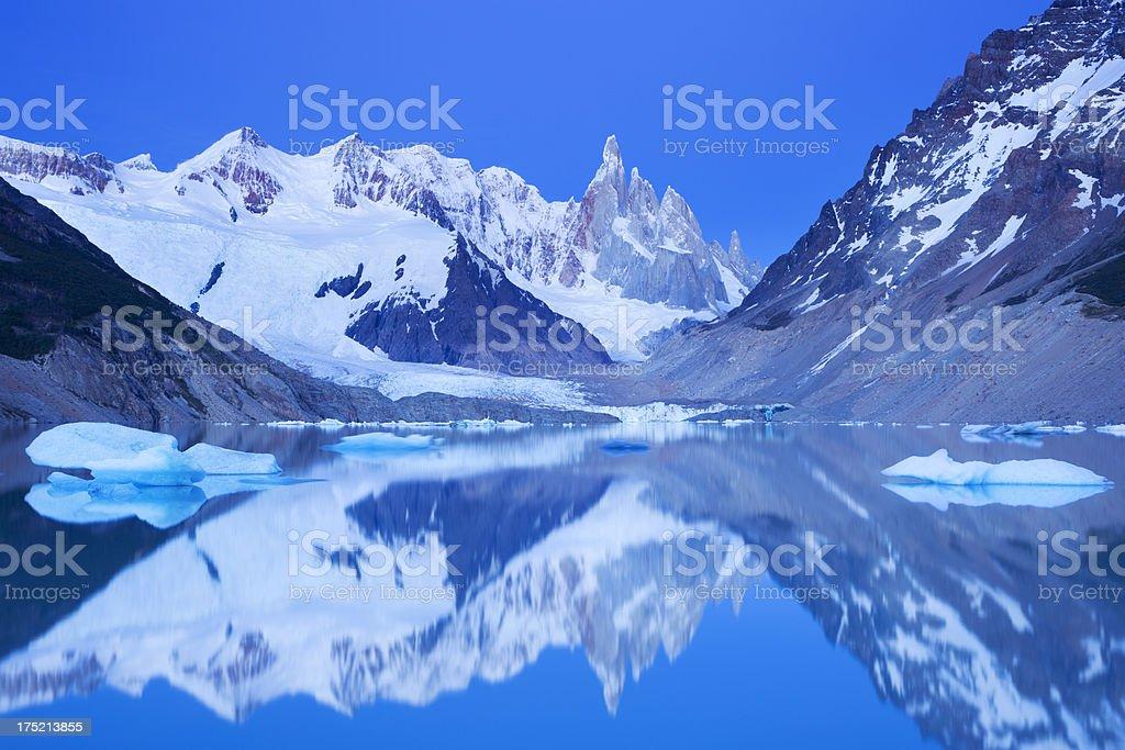 Cerro Torre, Patagonia, Argentina reflected in lake below, at dawn stock photo