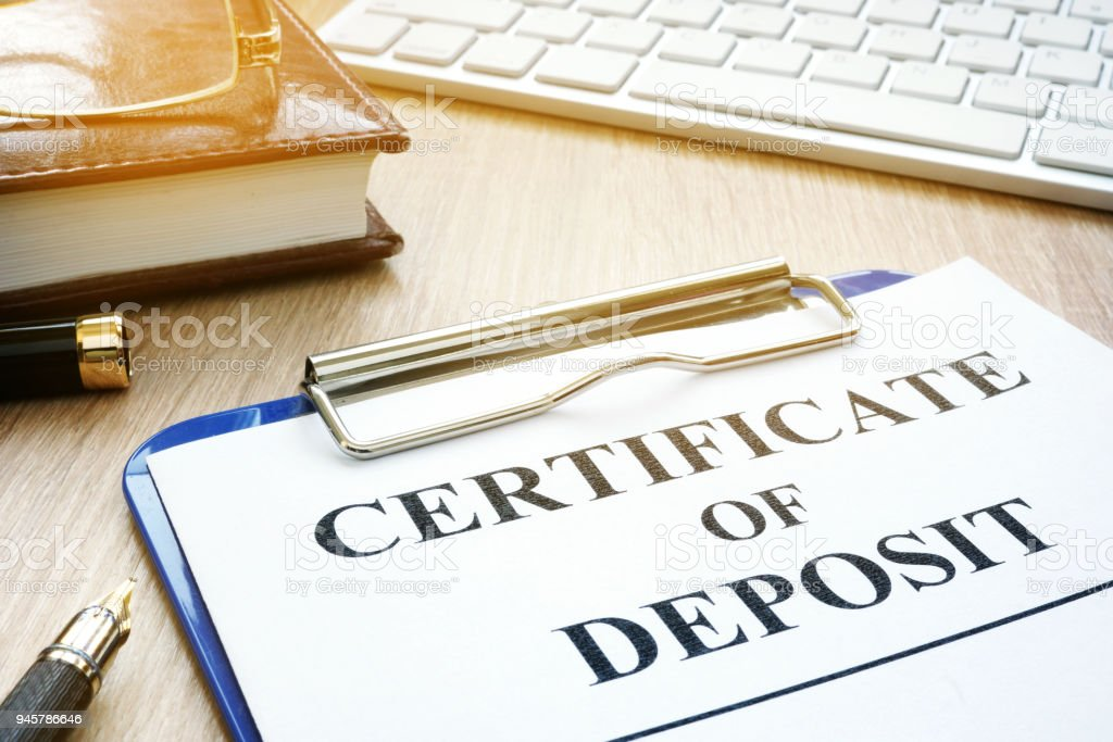 Certificate of deposit and pen on a desk. stock photo