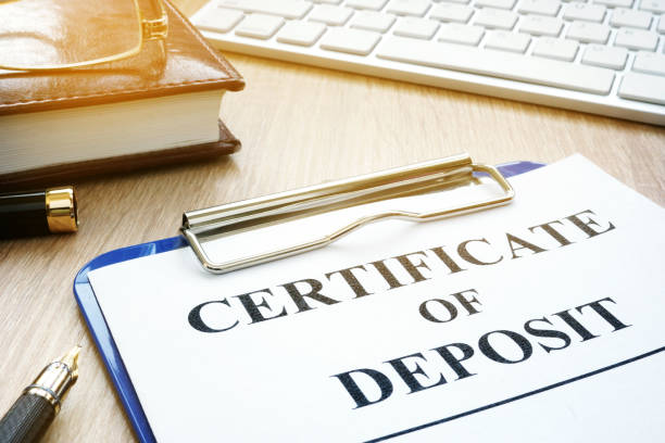 certificate of deposit and pen on a desk. - bank deposit slip stock pictures, royalty-free photos & images