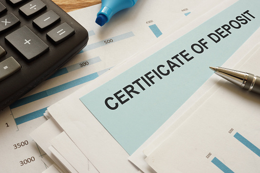 certificate of deposit CD is shown on a conceptual business photo