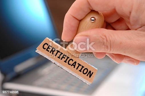 istock certification printed on rubber stamp in hand 937746598