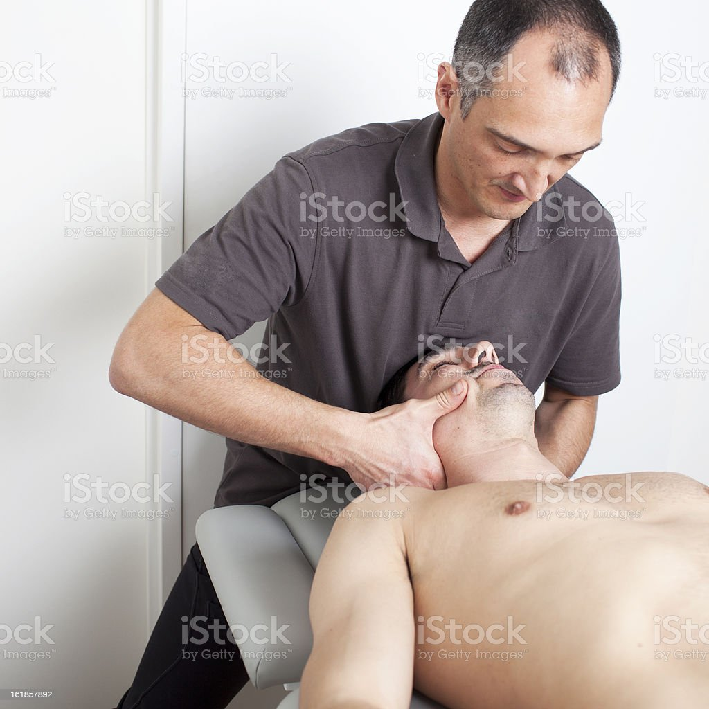cervical manipulation stock photo