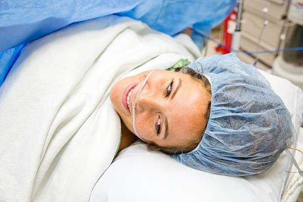 cesarean section c-section birth mother and newborn - c section stock photos and pictures
