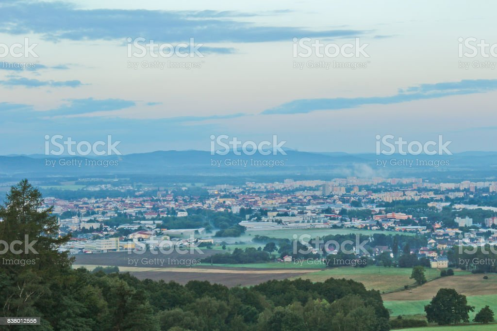 Ceske Budejovice in morning fog with trees in front, Czech landscape stock photo