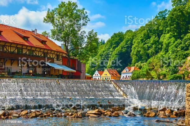 Photo of Cesky Krumlov Czech Republic. Cascade dam at river