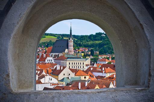 Cesky Krumlov in the stronghold wall window, Czech Republic