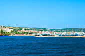 Cesme, Turkey - June 19, 2019 : Panoramic view of Cesme Town and Old Ottoman Cesme Castle view in. Cesme is populer tourist destination in Izmir Province.