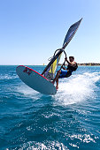 Cesme, Turkey, June 28, 2015. Windsurfing in Alacati. Extreme Sport Windsurfing. Windsurfers ride the waves.