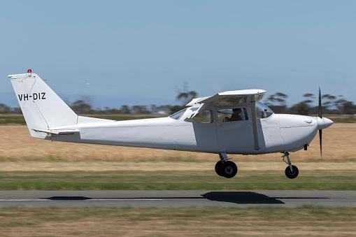 Lethbridge, Australia - November 23, 2014: 1963 Cessna 172E Skyhawk four seat single engine light aircraft VH-DIZ landing at Lethbridge airfield.
