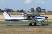 Sydney, Australia - July 4, 2020: Cessna 172S aircraft flying at the distance. Registration; VH-FWC.