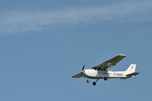 Front end view of small airplane. Cessna 172.