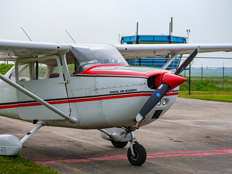 Cessna 172 Skyhawk small four-seat, single-engine, high wing, fixed-wing aircraft parked at the tarmac of Lelystad airport in Flevoland, The Netherlands