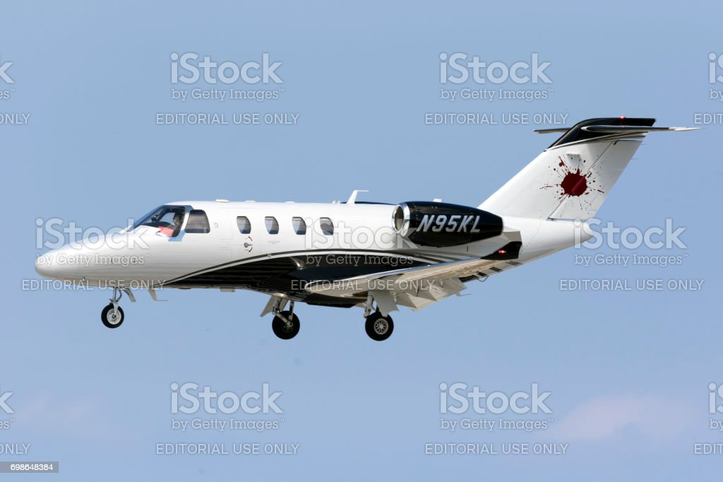 Cessna Jet executive landing runway 31 in the afternoon. stock photo