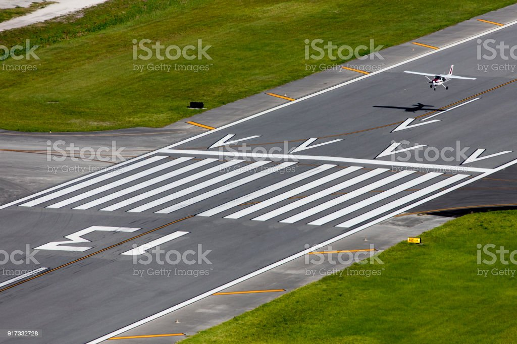 Cessna landing stock photo