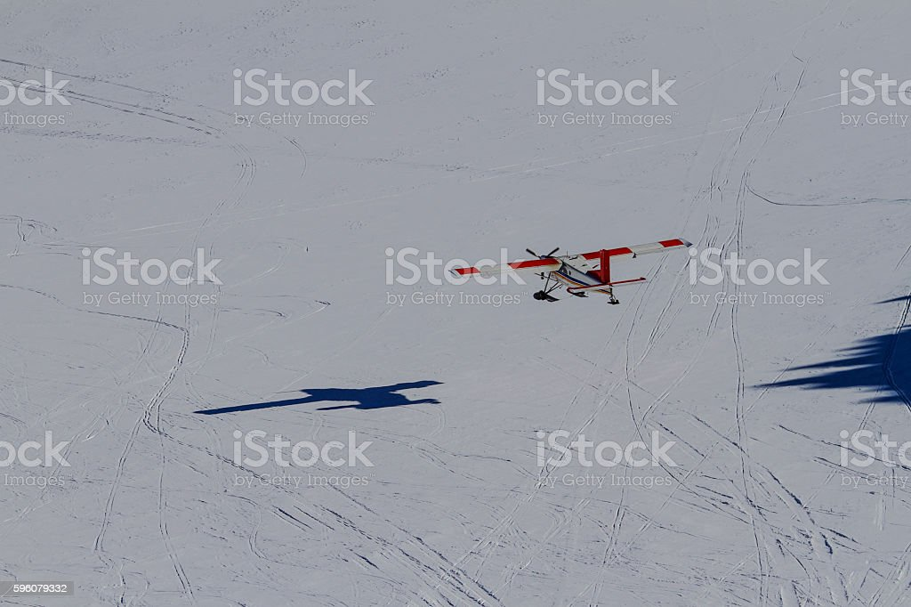 Cessna plane flying on snow background royalty-free stock photo