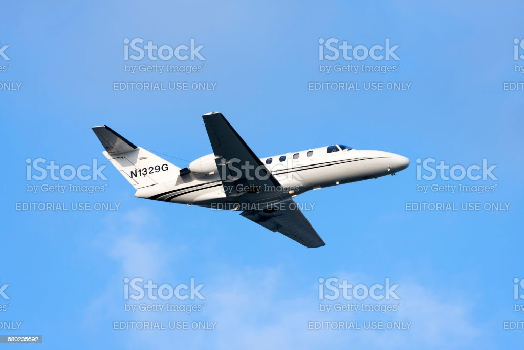 Cessna Private Jet climbing after take off stock photo