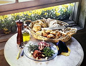 basket of breads and condiments