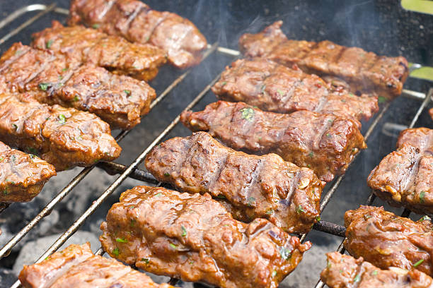 Cevapcici on the grill stock photo