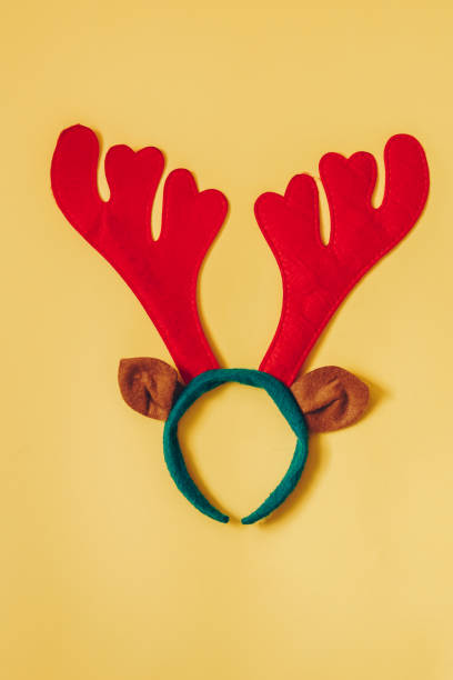 cflat lay top view of reindeer antlers on yellow background. perfect for a merry xmas greeting card. enough room for copy space. - antlers stock photos and pictures