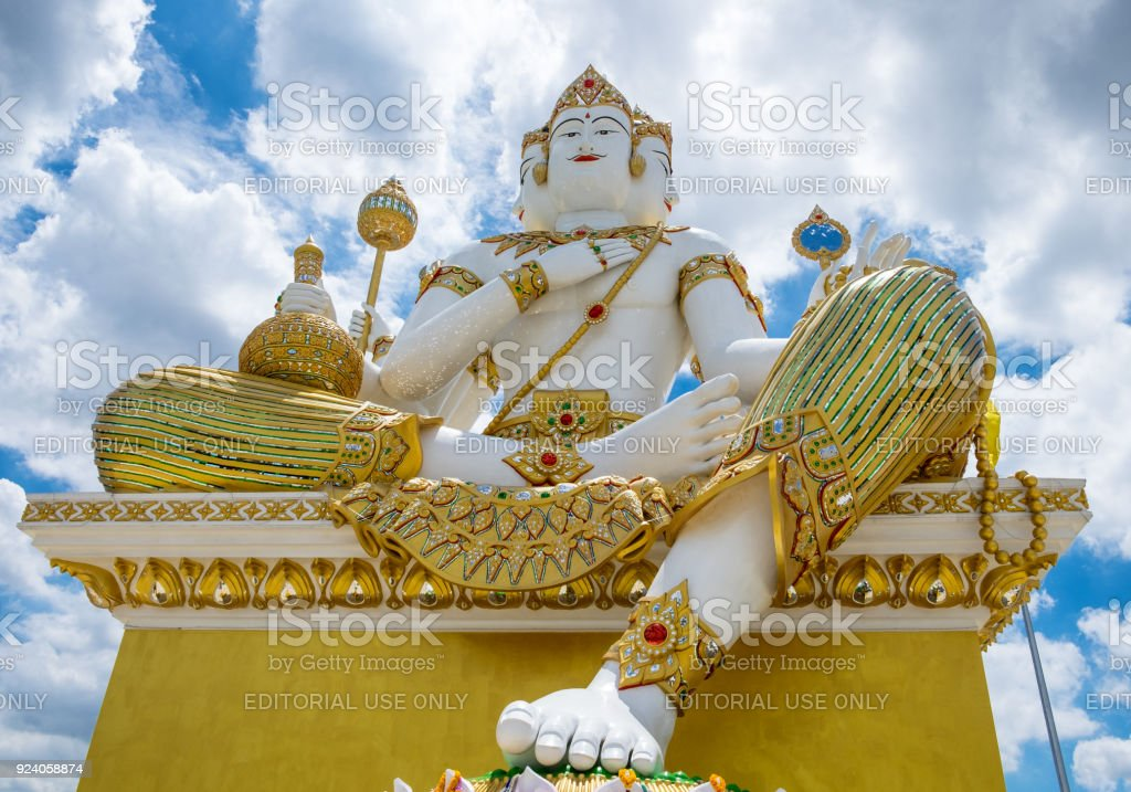 Chachoengsao,Thailand - Aug 24 2015 : God brahma large statue in front and blue sky in wat saman rattanaram stock photo