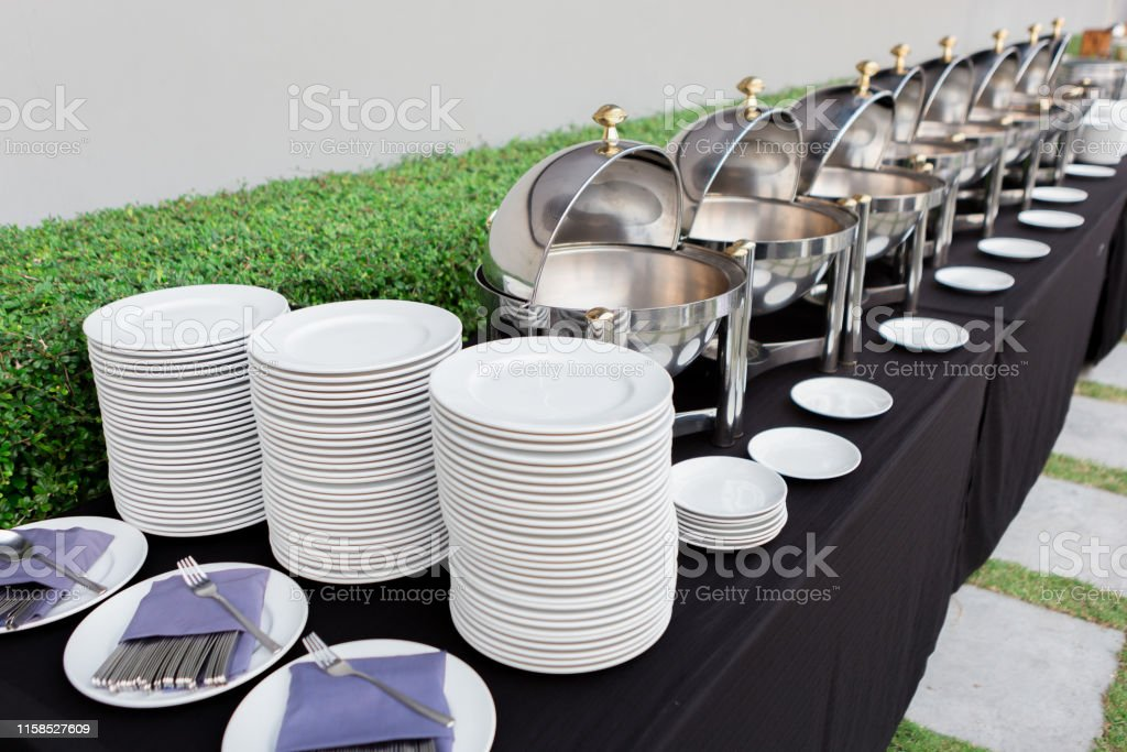Chafing dishes on the table at the luxury banquet