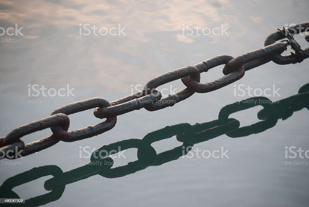 Chain above water stock photo
