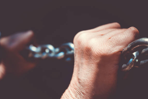 Chain and arthritis hands stock photo