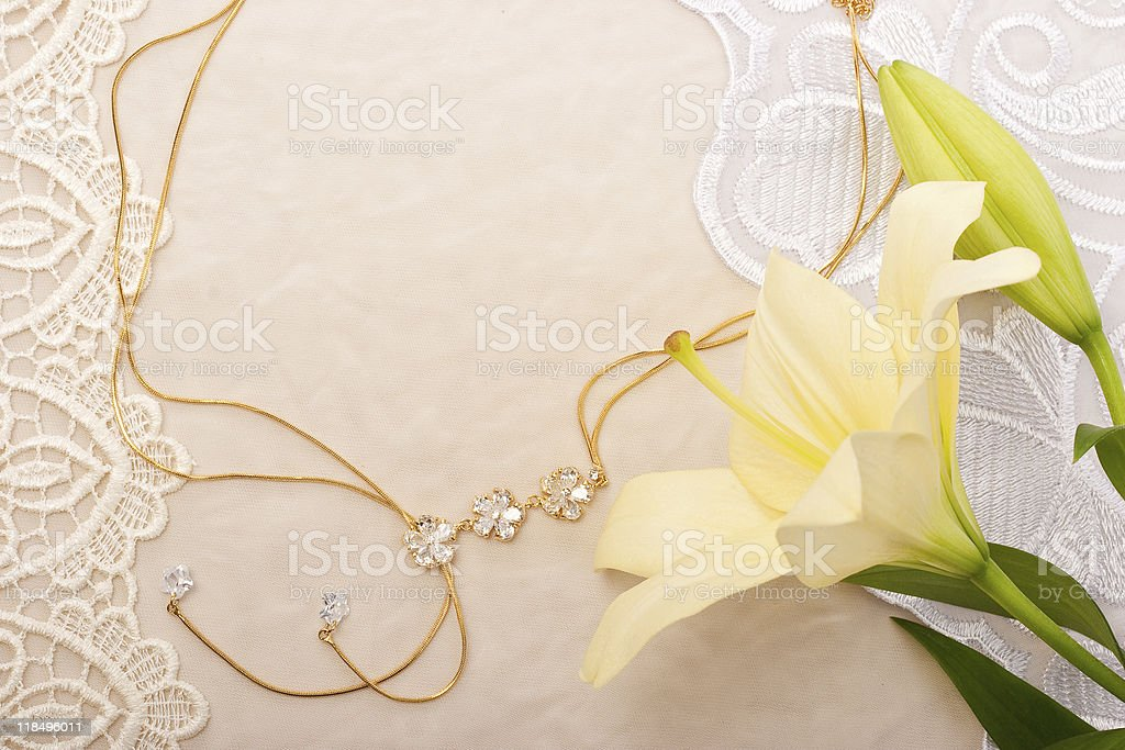 Chain and lily on lace background royalty-free stock photo