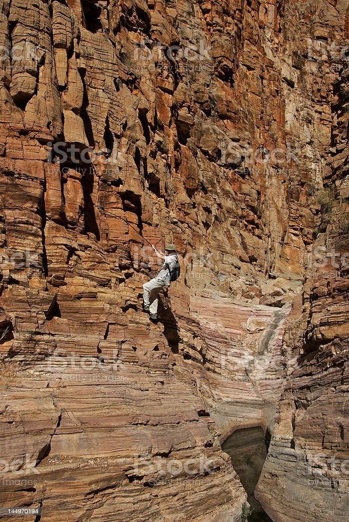 Chain climbing in canyon stock photo