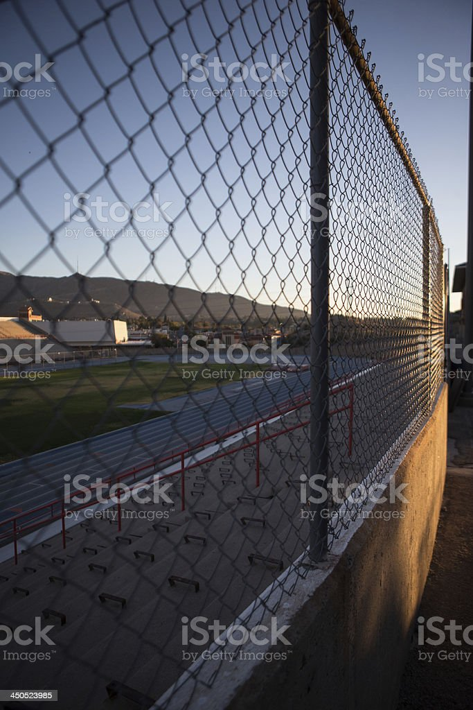 Chain Link Fence around a track and field stadium royalty-free stock photo