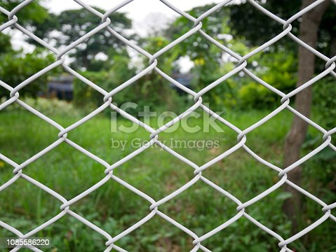 istock chain link fence 1085586220