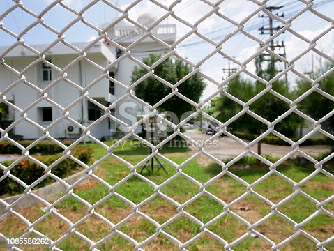 istock chain link fence 1085586262