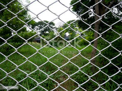 istock chain link fence 1086399660