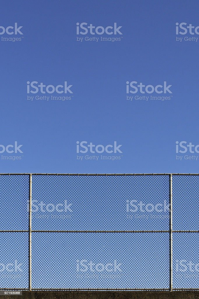 Chain link fence taking up half of the image stock photo