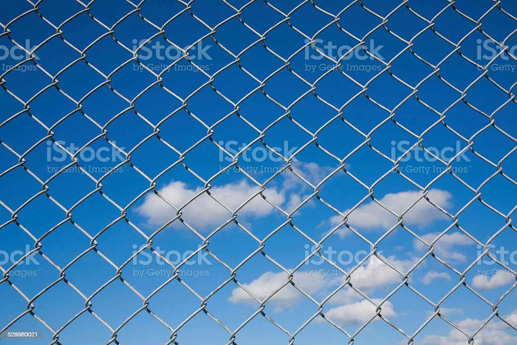 Chain Link Fence With Blue Sky Background stock photo