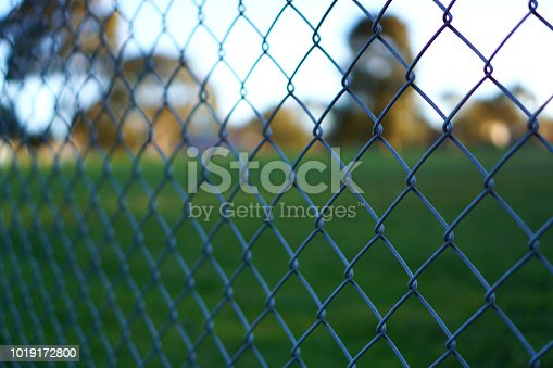 Chain link fence with blurred background of empty park