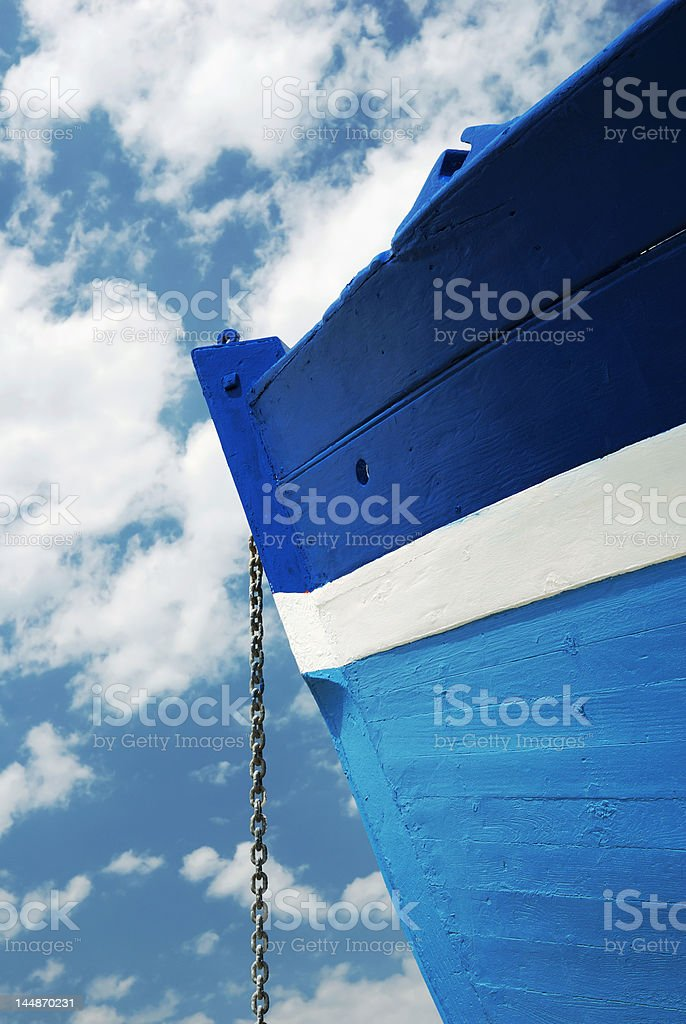 Chain of a white and blue wooden boat royalty-free stock photo